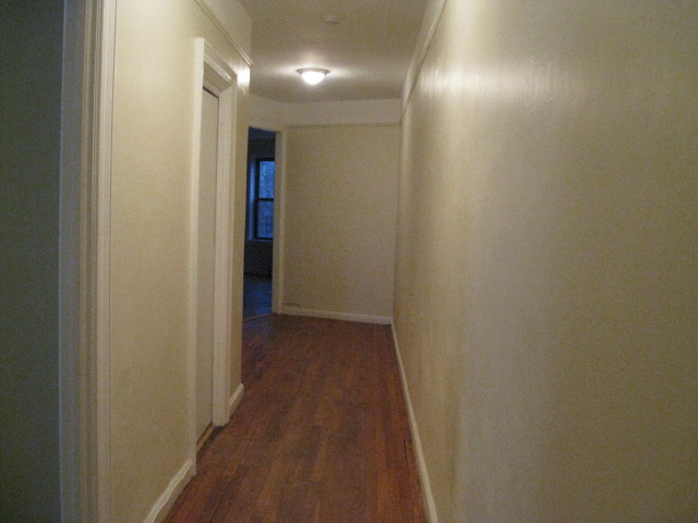 Strong hold property management Hallway to master bedroom